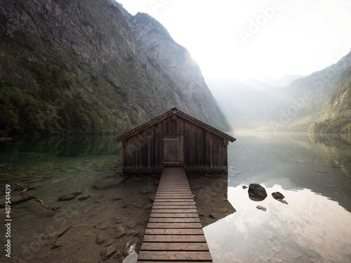 Canvas Panorama reflection of old wooden boat house shed alpine mountain lake Obersee K