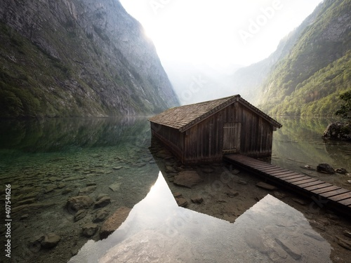 Panorama reflection of old wooden boat house shed alpine mountain lake Obersee K Fotobehang