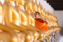 Asian Young Novice Monk Are Covering Cloth Buddha Statue In Wat Phutthai Sawan Temple, Ayutthaya, Thailand