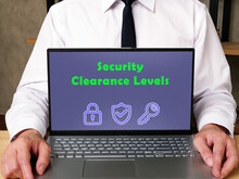 Financial Concept About Security Clearance Levels With Phrase On The Piece Of Paper.