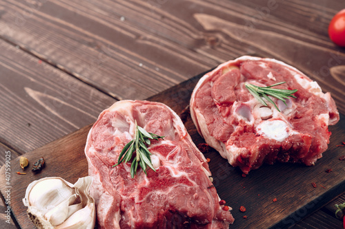 Canvas Raw meat beef shank slices on brown wooden board