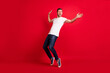 Leinwandbild Motiv Full body portrait of excited handsome person look empty space partying isolated on maroon color background