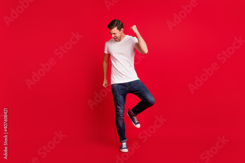 Full size portrait of impressed guy fist up open mouth shout yeah celebrate isol Fototapet
