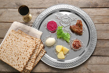 Passover Seder Plate With Traditional Food On Table