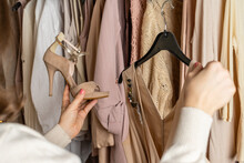 Woman Choosing Summer High-heeled Shoes And Stylish Dress In Home Cupboard.
