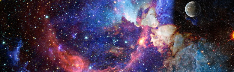 Colorful cosmos with stardust and milky way. Magic color galaxy. Infinite universe and starry night.Elements of this image furnished by NASA