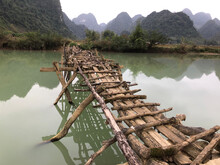 Old Dangerous Abandonned Bamboo Bridge Crossing A River In The  Trung Khan District, Cao Bang Province, Vietnam