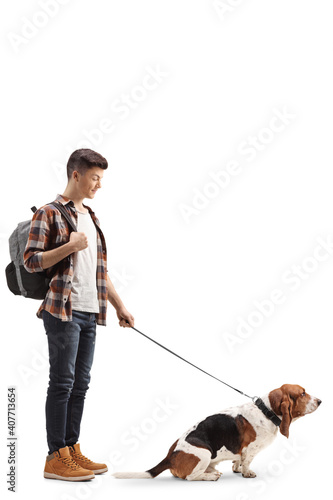 Papel de parede Full length shot of a male student with a basset hound on a lead