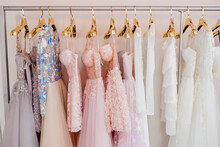 Collection Of  Beautiful Evening Dresses Hanging On Rack In Dressing Room. Clothing On Hanger At The Modern Shop Boutique. Clothes Hanging On Rack, Close Up