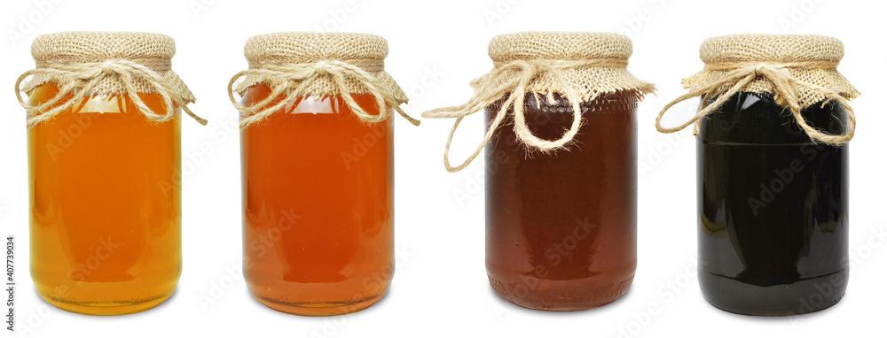 Fototapeta floral honeydew honey in a jar isolated over white