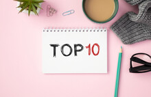 Top 10 Written On Paper Sheet On Pink Background