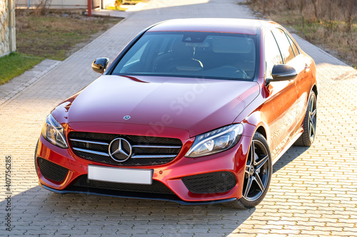 Frankfurt, Germany - September 27, 2020: New bright red Mercedes Benz C-class parked outside on a street.