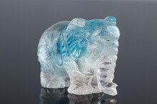 Beautiful Statuette Elephant From The Mineral Topaz On A Gray Background
