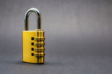 Close-up Combination Lock With Chrome Numerals On Black Background.