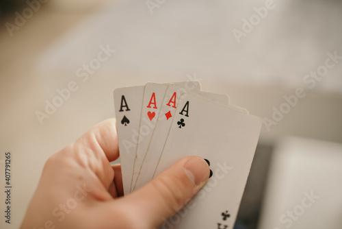 Fotografie, Obraz Closeup shot of hands holding playing cards