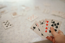 Closeup Shot Of Hands Holding Playing Cards