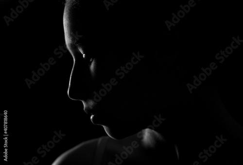 Fototapeta premium Portrait of a girl in a low key