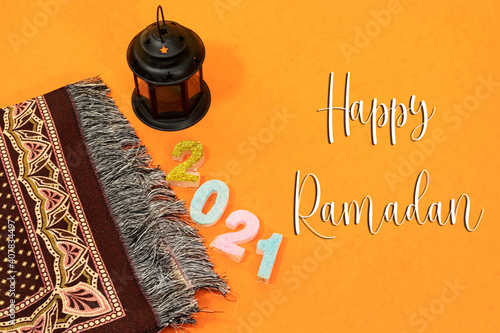 Fotografia Ornamental Arabic lantern with burning candle glowing and prayer mat