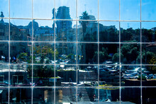 Haifa, Israel - January 21, 2021: City Buildings And People Are Reflected In The Mirrored Surface Of Another Building