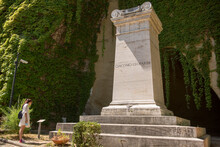 Tomb Of Giacomo Leopardi At The Vergiliano Park In Naples, Italy. The Mauseleo Consists Of A Column And A Marble Inscription.