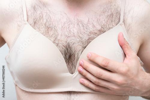Obraz na plátne Naked hairy man in a bra, cropped image, close-up