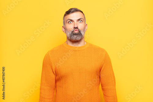 Obraz na plátně adult handsome man looking goofy and funny with a silly cross-eyed expression, j