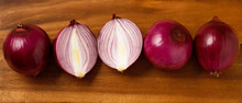 Full Frame Shot Of Purple Onions. Fresh Whole And One Sliced. Wooden Cutting Board Background. Copy Space Banner.