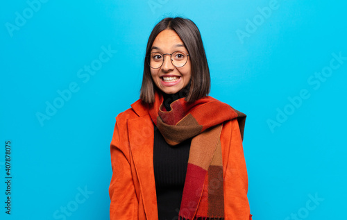 Fotografie, Obraz hispanic woman looking happy and goofy with a broad, fun, loony smile and eyes w