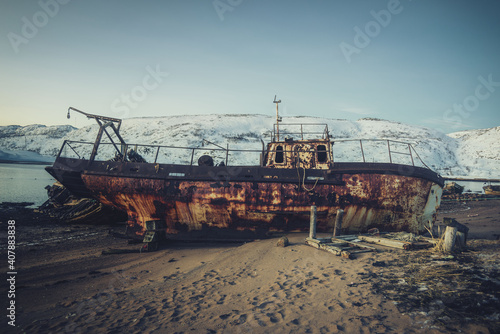Fototapeta Abandoned ship on the beach of Teriberka. Kola peninsula.