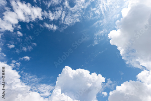 Fototapeta Beautiful blue clear sky with white cumulus clouds (cumulonimbus), bottom view, full frame, photography. obraz