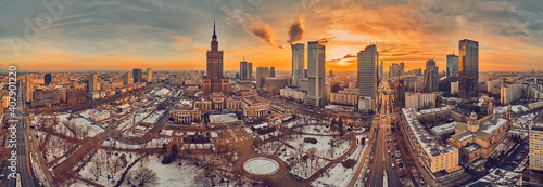 Obraz na plátně Beautiful panoramic aerial drone view on All Saints Church - Roman Catholic church located at Grzybowski Square, Warsaw City Skyscrapers, PKiN, and Varso Tower under construction