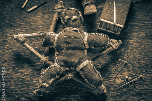 Fotografering Closeup of voodoo doll pierced by a needle as harming