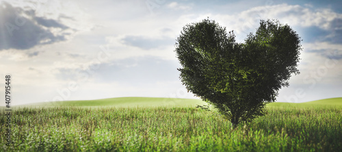 Drzewo w kształcie serca na zielonym polu. Miłość, walentynki, ekologiczne środowisko.