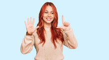 Young Redhead Woman Wearing Casual Winter Sweater Showing And Pointing Up With Fingers Number Seven While Smiling Confident And Happy.