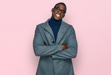 Young African American Man Wearing Business Clothes And Glasses Happy Face Smiling With Crossed Arms Looking At The Camera. Positive Person.