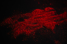 Scattered Red Heart Made Of Sparkles On A Black Background. Shimmering Dust Symbol.