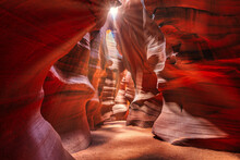 Beautiful Wide Angle View Of Sandstone Formations In Famous Antelope Canyon On A Sunny Day Filtering Light Rays, Page, American Southwest, Arizona, USA.