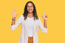Young African American Girl Wearing Business Clothes Showing And Pointing Up With Fingers Number Seven While Smiling Confident And Happy.