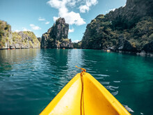 Beautiful View Of A Yellow Boat, Hills And The Water At The El Nido Resort In The Philippines