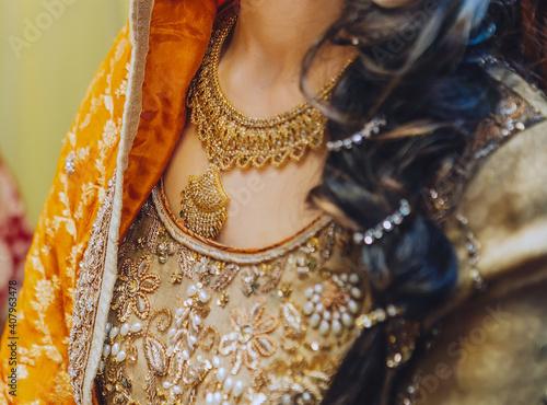 Billede på lærred Chest of indian pakistani bride wear inlaid yellow festive dress and massive gol