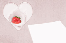 Heart With Strawberries And Blank Paper On A Painted Wooden Background. Tinted In Pink