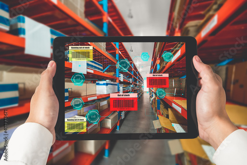 Obraz Smart warehouse management system using augmented reality technology to identify package picking and delivery . Future concept of supply chain and logistic business . - fototapety do salonu