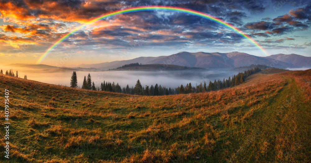 Fototapeta Rainbow over the Mountains. autumn morning in the Carpathians