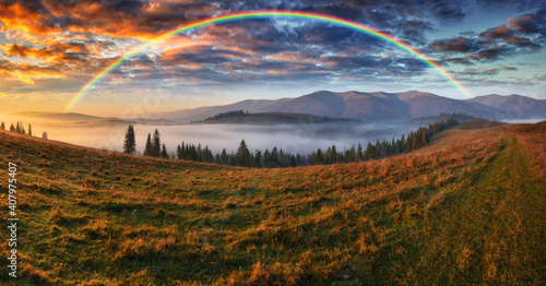 Obraz Rainbow over the Mountains. autumn morning in the Carpathians - fototapety do salonu