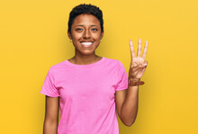 Young African American Woman Wearing Casual Clothes Showing And Pointing Up With Fingers Number Three While Smiling Confident And Happy.