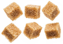 Brown Sugar Cubes On White Background. Macro Picture.