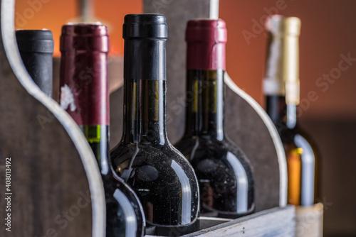 Wine bottles in wooden crate and oak wine keg. © volff