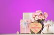 Leinwandbild Motiv Gift Box with sweet carnation flowers