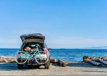 Car With Bikes On The Beach