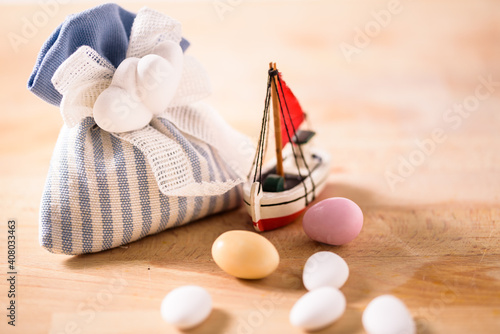 the almonds and the boat. still life with sugared almonds and a boat. gift for wedding and newborn celebration © marinzolich